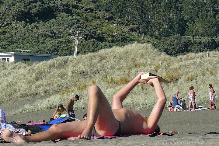 Avid Reader at South Piha Beach