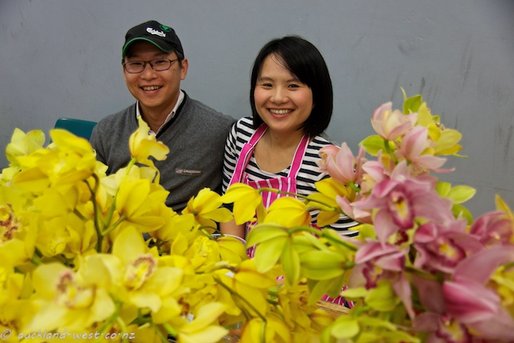 Smiles from John, Momo, and their orchids